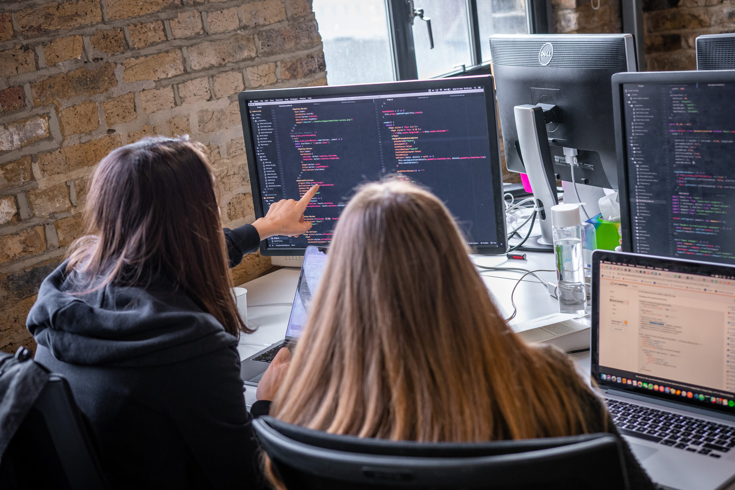 Women coding together